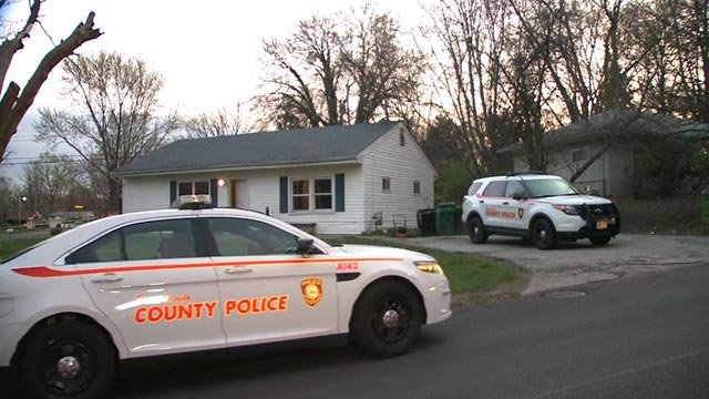 Police outside a home on Northdale in Spanish Lake after a triple homicide (Credit: KMOV)