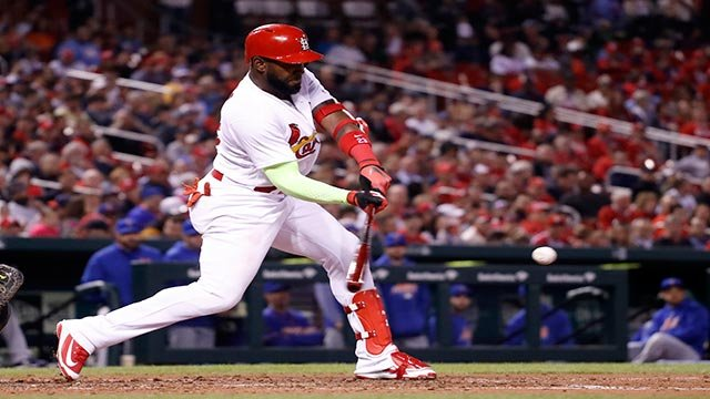 St. Louis Cardinals' Marcell Ozuna hits a two-run single during the third inning of a baseball game against the New York Mets on Wednesday, April 25, 2018, in St. Louis. (AP Photo/Jeff Roberson)