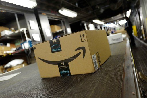 In this Tuesday, May 9, 2017, photo, a package from Amazon Prime moves on a conveyor belt at a UPS facility in New York. (AP Photo)