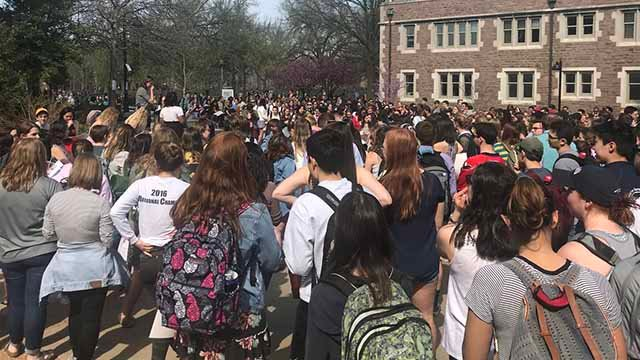 Hundreds of Washington University students attended a rally at the Danforth University Center to call for improvements to the process of investigating sexual assaults on campus. Credit: KMOV