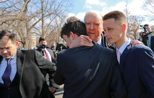 Sen. Orrin Hatch, R-Utah, center, hugs Kyle Kashuv, 16, and Patrick Petty, 17, both from Parkland, Fla., following a news conference on Capitol Hill in Washington, Tuesday, March 13, 2018.  (AP Photos)