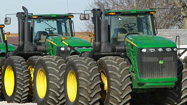 John Deere farm tractors at Sloan's Implement John Deere Dealership, in Virden, Ill. (Credit: AP Photo / Seth Perlman)