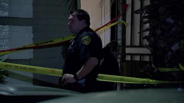Investigators outside a Houston apartment complex after a boy died after being found in a dryer (Credit: KTRK / CNN)