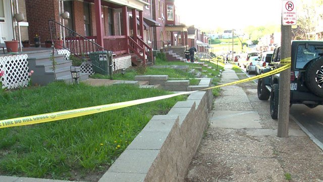 Investigators process the scene where a man ,30, was shot in the head near Minerva Ave and Montclair Ave in North St. Louis (Credit: KMOV)