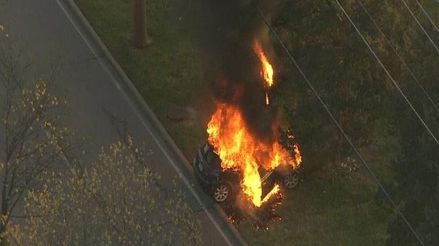 A car caught fire on New Ballas Monday (Credit: KMOV)