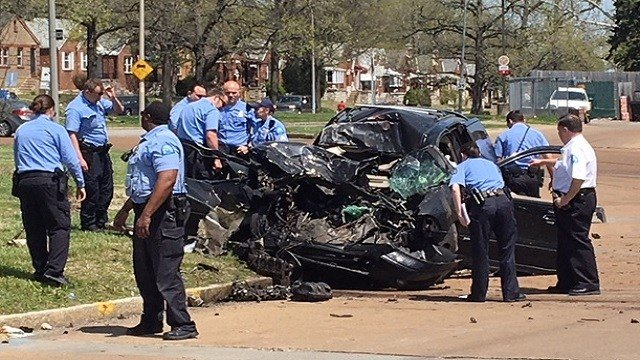Police surround a car involved in an accident Monday afternoon (KMOV)