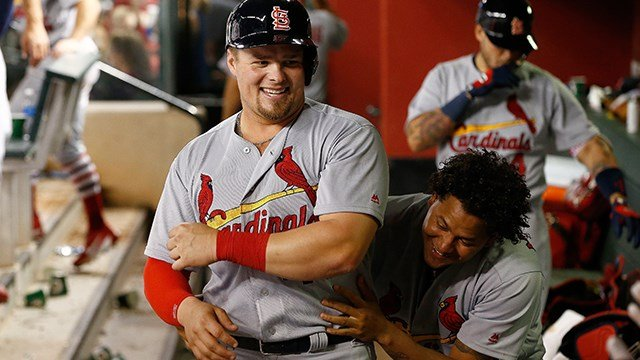St. Louis Cardinals' Luke Voit, left, smiles as he gets a hug from pitcher Carlos Martinez after Voit scored against the Arizona Diamondbacks during the seventh inning of a baseball game Tuesday, June 27, 2017, in Phoenix. (AP Photo/Ross D. Franklin)