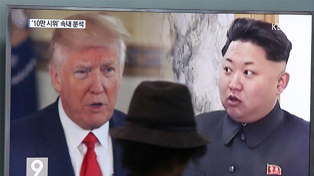 A man watches a television screen showing U.S . President Donald Trump, left, and North Korean leader Kim Jong Un during a news program at the Seoul Train Station in Seoul, South Korea. (AP Photo/Ahn Young-joon, File)