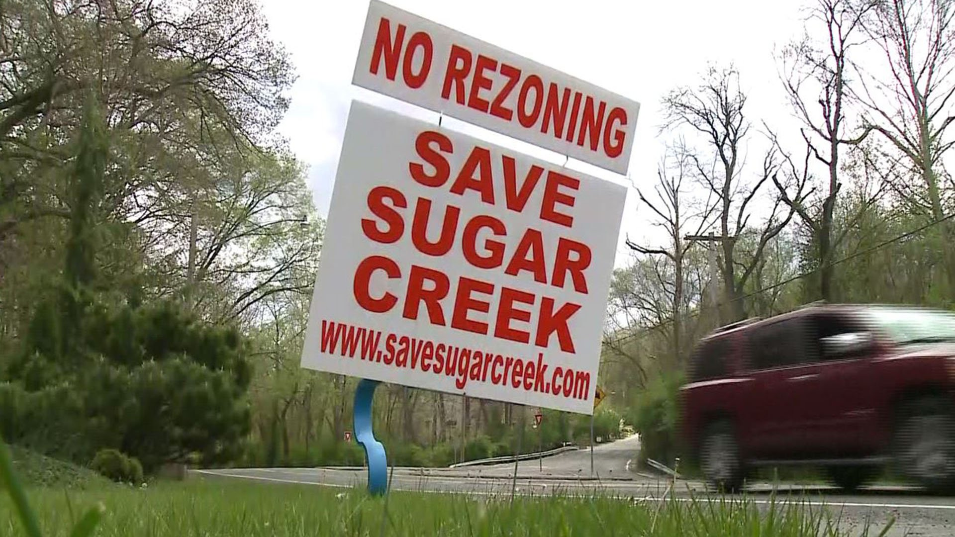 Neighbors in the Sugar Creek Valley neighborhood of Kirkwood are rallying support to oppose a zoning change. (Credit: KMOV)