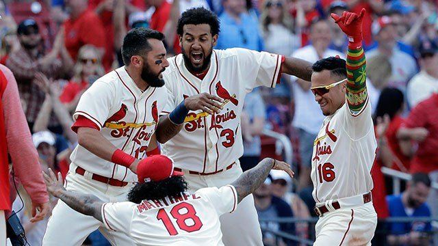 St. Louis Cardinals' Kolten Wong (16) celebrates his walkoff home run with teammates Carlos Martinez (18), Jose Martinez (38) and Matt Carpenter during the 10th inning of a baseball game against the Chicago Cubs, Saturday. ( Credit: AP )
