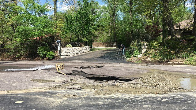A water main break in South County created a 4 feetby 18 feet hole in the pavement.