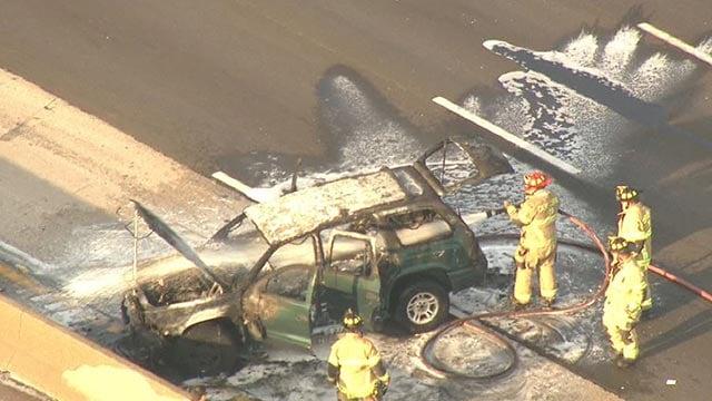 Crews extinguishing flames on SB I-270 Monday (Credit: KMOV)