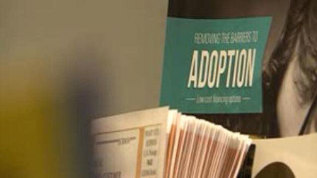 Paperwork on a desk at a St. Louis adoption agency (Credit: KMOV)