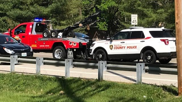 A St. Louis County vehicle being towed away after a crash Tuesday morning (Credit: Ray Preston / News 4)