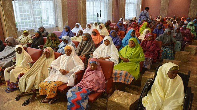 Recently freed School girls from the Government Girls Science and Technical College Dapchi, during a meeting with Nigeria President, Muhammadu Buhari, at the Presidential palace in Abuja, Nigeria, Friday March 23, 2018. (Credit: AP Photo/Azeez Akunleyan)