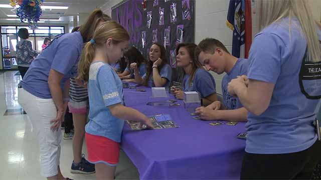 Recently, Fort Zumwalt High School students visited Ostmann Elementary in O'Fallon, Mo. to sign their own playing cards. The high school students are part of the district's Leader in Me Program. Credit: KMOV