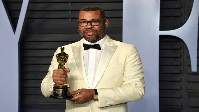 "Jordan Peele, winner of the award for best original screenplay for ""Get Out,"" arrives at the Vanity Fair Oscar Party on Sunday, March 4, 2018, in Beverly Hills, Calif. (Photo by Evan Agostini/Invision/AP)"