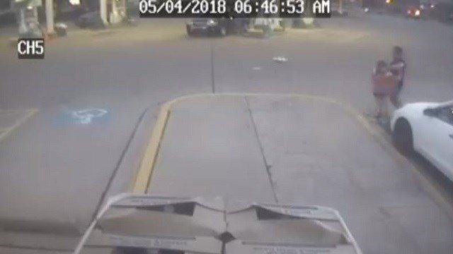 Surveillance video shows an 11-year-old girl jumping out of a carjacked SUV in suburban Chicago as her father tries to stop a car driven by the carjacker's accomplice. (Credit: Aurora PD)