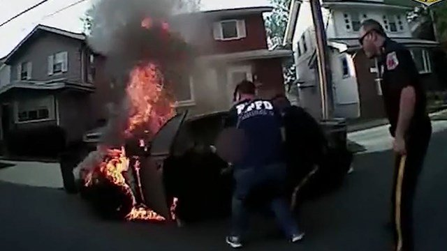 NJ police rescue man from burning vehicle