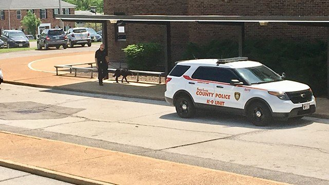 St. Louis County Police Officers and their canine officers are on scene conducting a thorough search of Sperreng Middle School in Sappington, Mo. (Credit: KMOV)