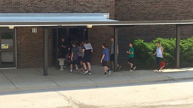 Sperreng Middle School students directed back into school after being evacuated for a threat. (Credit: KMOV)