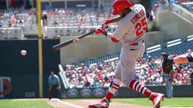 St. Louis Cardinals' Dexter Fowler hits a two-run single off Minnesota Twins pitcher Lance Lynn in the first inning of a baseball game Wednesday, May 16, 2018, in Minneapolis. (AP Photo/Jim Mone)