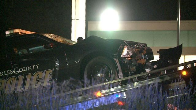 A St. Charles County police cruiser being placed on a tow truck bed after a pedestrian was struck and killed (Credit: KMOV)