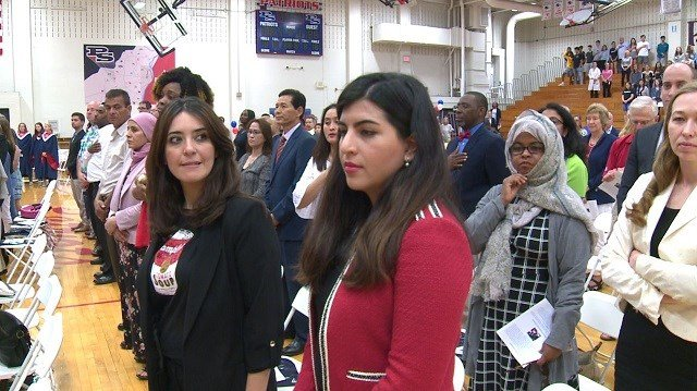 Fifty local immigrants become citizens of the US at Parkway South High School Thursday evening. (Credit: KMOV)