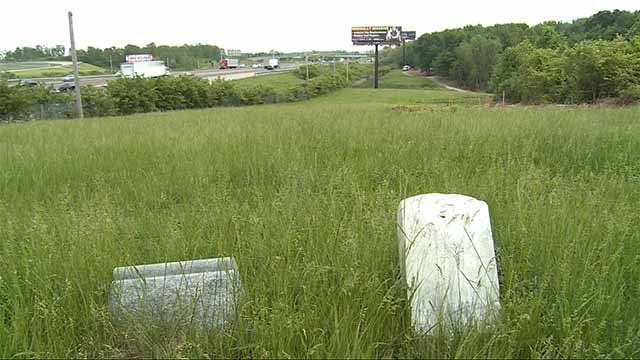 Many say billboards on the grounds of Washington Park Cemetery are disrespectful to the people buried there. Credit: KMOV