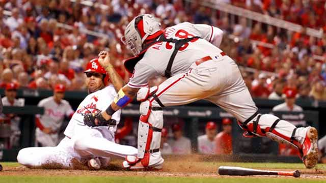 St. Louis Cardinals' Jose Martinez, left, is tagged out at home by Philadelphia Phillies catcher Jorge Alfaro during the eighth inning of a baseball game Thursday, May 17, 2018, in St. Louis. (AP Photo/Jeff Roberson)