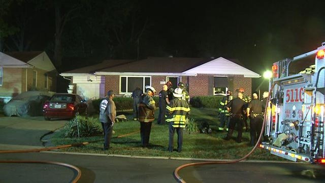 Firefighters outside a home on Longridge Drive after a fire (Credit: KMOV)