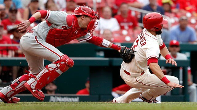 St. Louis Cardinals' Matt Carpenter, right, is tagged out by Philadelphia Phillies catcher Andrew Knapp during the seventh inning of a baseball game Saturday, May 19, 2018, in St. Louis. (AP Photo/Jeff Roberson)