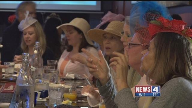 Attendees dressed in British bonnets and fascinators during a Royal Wedding watch party in the Central West End. (Credit: KMOV)
