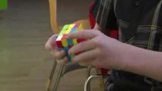 Jackson Bruegger can solve a Rubik's Cube in as little as 19 seconds (Credit: KMOV)