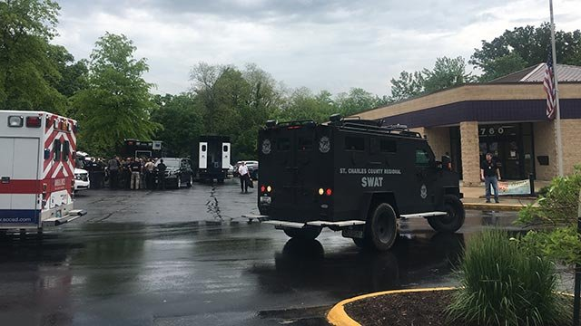 The staging area while police were on the scene of a hostage situation in St. Charles (Credit: Alexis Zotos / News 4)