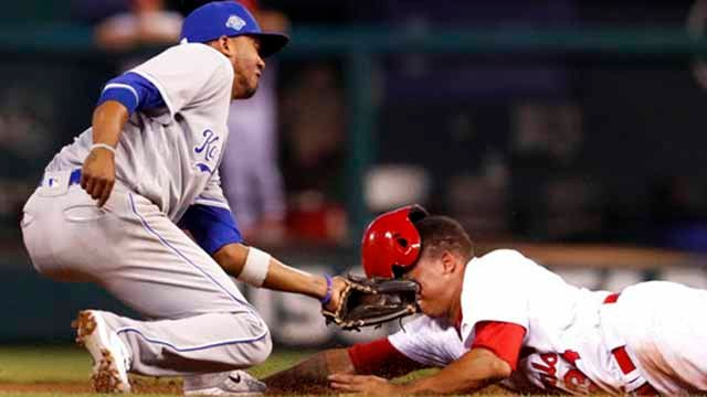 St. Louis Cardinals' Yairo Munoz, right, is tagged out by Kansas City Royals shortstop Alcides Escobar while attempting to steal second during the fourth inning of a baseball game Tuesday, May 22, 2018, in St. Louis. (AP Photo/Jeff Roberson)