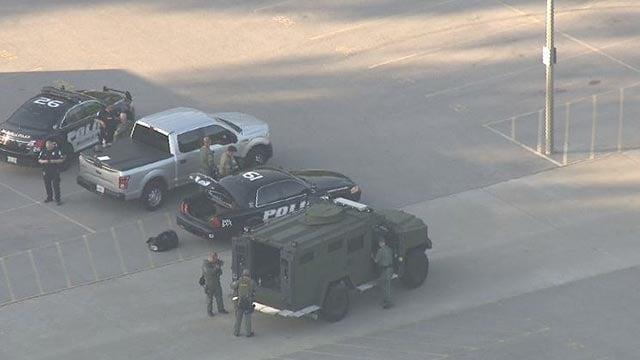 Police outside Belleville East High School Wednesday (Credit: KMOV)