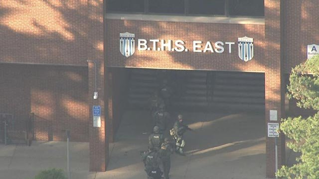 Police entering Belleville East High School after a 'credible threat' (Credit: KMOV)