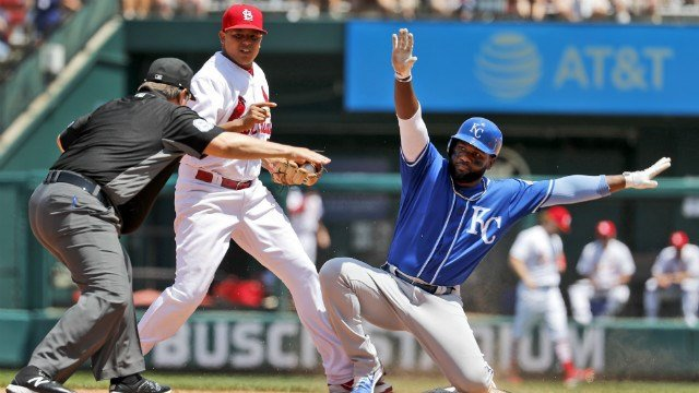 Kansas City Royals' Abraham Almonte, right, is safe at second as second base umpire Doug Eddings, left, makes the call. (Credit: AP Images