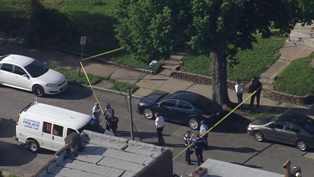 Police in the 4300 block of Gibson Avenue after a man's body was found Thursday (Credit: KMOV)