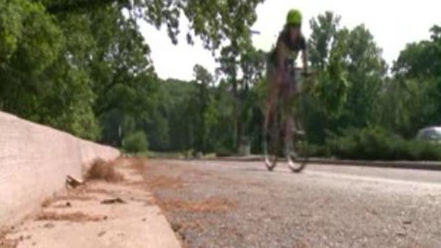 Sandi Essner riding her bicycle (Credit: KMOV)