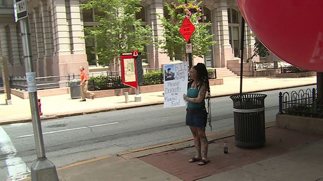 For hours Friday Jeni Shurley and and Kelley's wife Amy Rickords were in downtown St. Louis on the street holding signs, trying to tell anyone who would listen their story and  asking for donations. (Credit: KMOV)