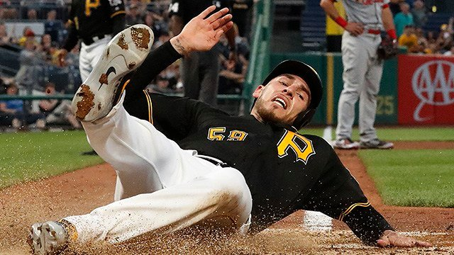 Pittsburgh Pirates' Joe Musgrove scores on a double by Josh Harrison during the sixth inning of a baseball game against the St. Louis Cardinals in Pittsburgh, Friday, May 25, 2018. (AP Photo/Gene J. Puskar)