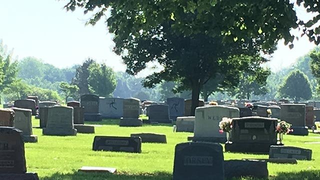 Black spray paint on headstones at the Sunset Hills Cemetery in Glen Carbon (Credit: Marielle Mohs / News 4)