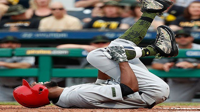 St. Louis Cardinals' Dexter Fowler grabs his knee after being hit by a pitch from Pittsburgh Pirates starter Trevor Williams in the fourth inning of a baseball game in Pittsburgh, Saturday, May 26, 2018. Fowler was helped off the field and left the game.