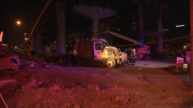 A semi-truck was damaged when it fell off the ramp to eastbound Poplar Street Bridge Monday (Credit: KMOV)