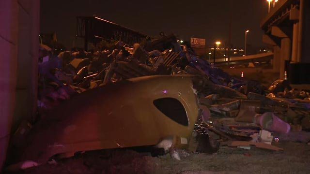 Contents of a semi-truck after it fell off an on ramp to the Poplar Street Bridge Monday (Credit: KMOV)
