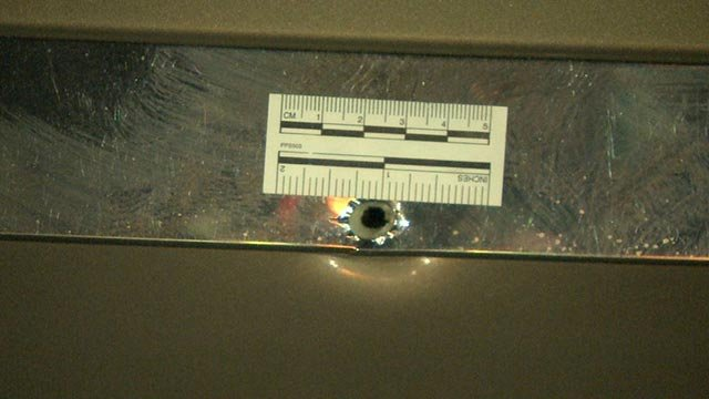 A bullet hole in the 3800 block of Gravois after a 15-year-old was shot Sunday (Credit; KMOV)