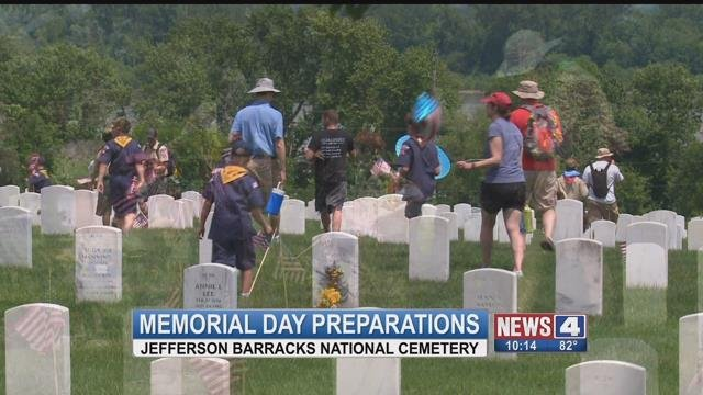 Boy Scouts laying flags at Jefferson Barracks National Cemetery ahead of Memorial Day (Credit: KMOV)