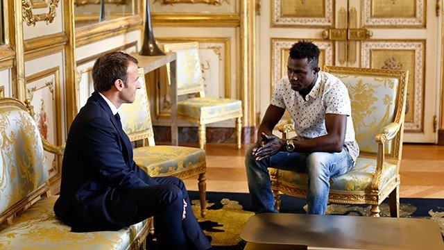 French President Emmanuel Macron, left, meets with Mamoudou Gassama, 22, from Mali, at the presidential Elysee Palace in Paris, Monday, May, 28, 2018.  (Credit: AP)